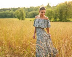 girl in field wearing a dress