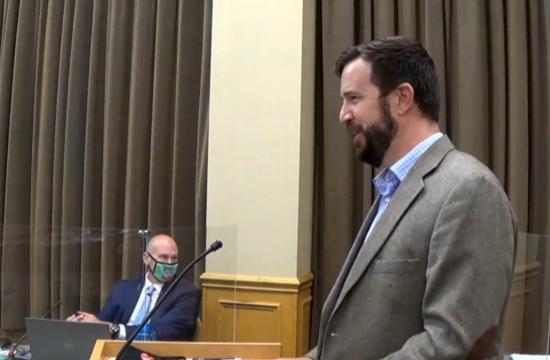 Man giving a speech at a podium