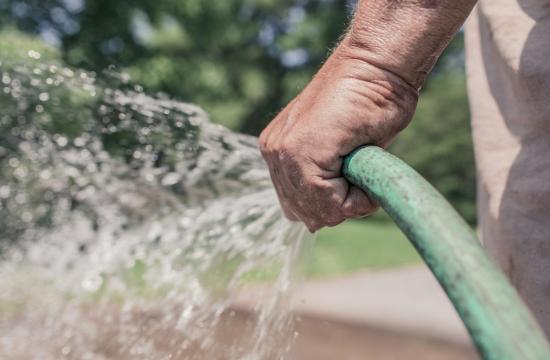 water hose spraying water