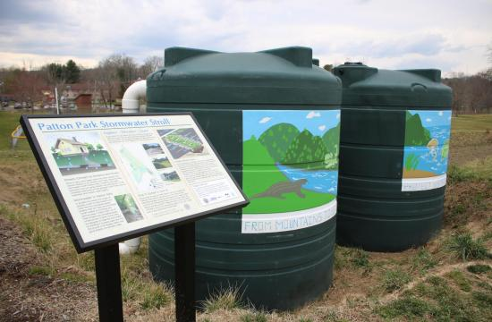 sign and 2 rainwater cisterns