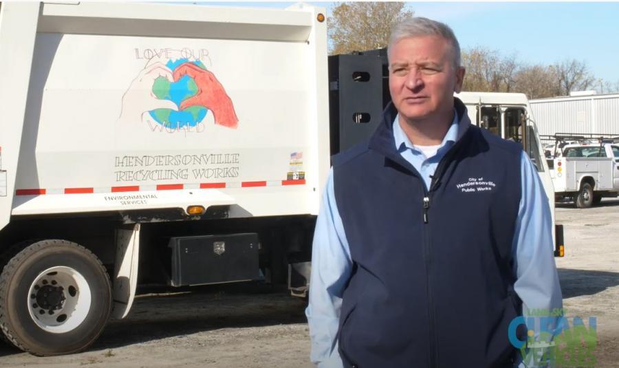 Man beside a recycling truck