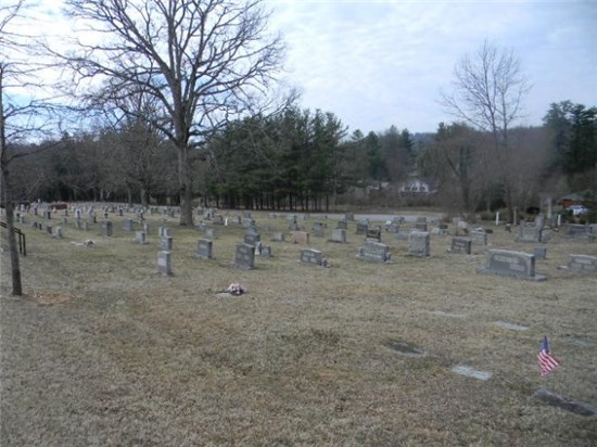 Photo overlooking several dozen plots at Oakdale Cemetery