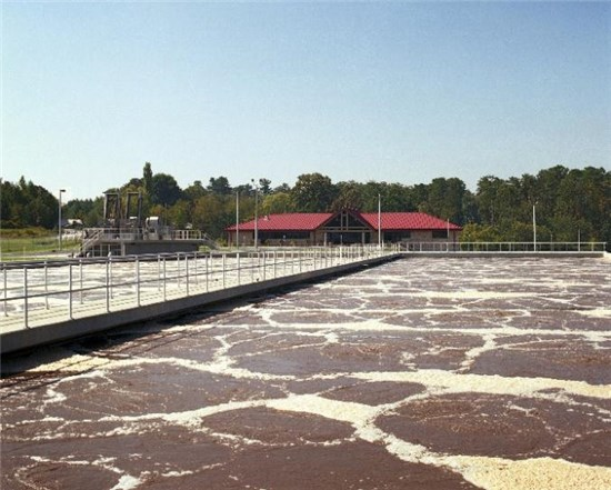 Photo of aeration basin and lab building at wastewater treatment plant