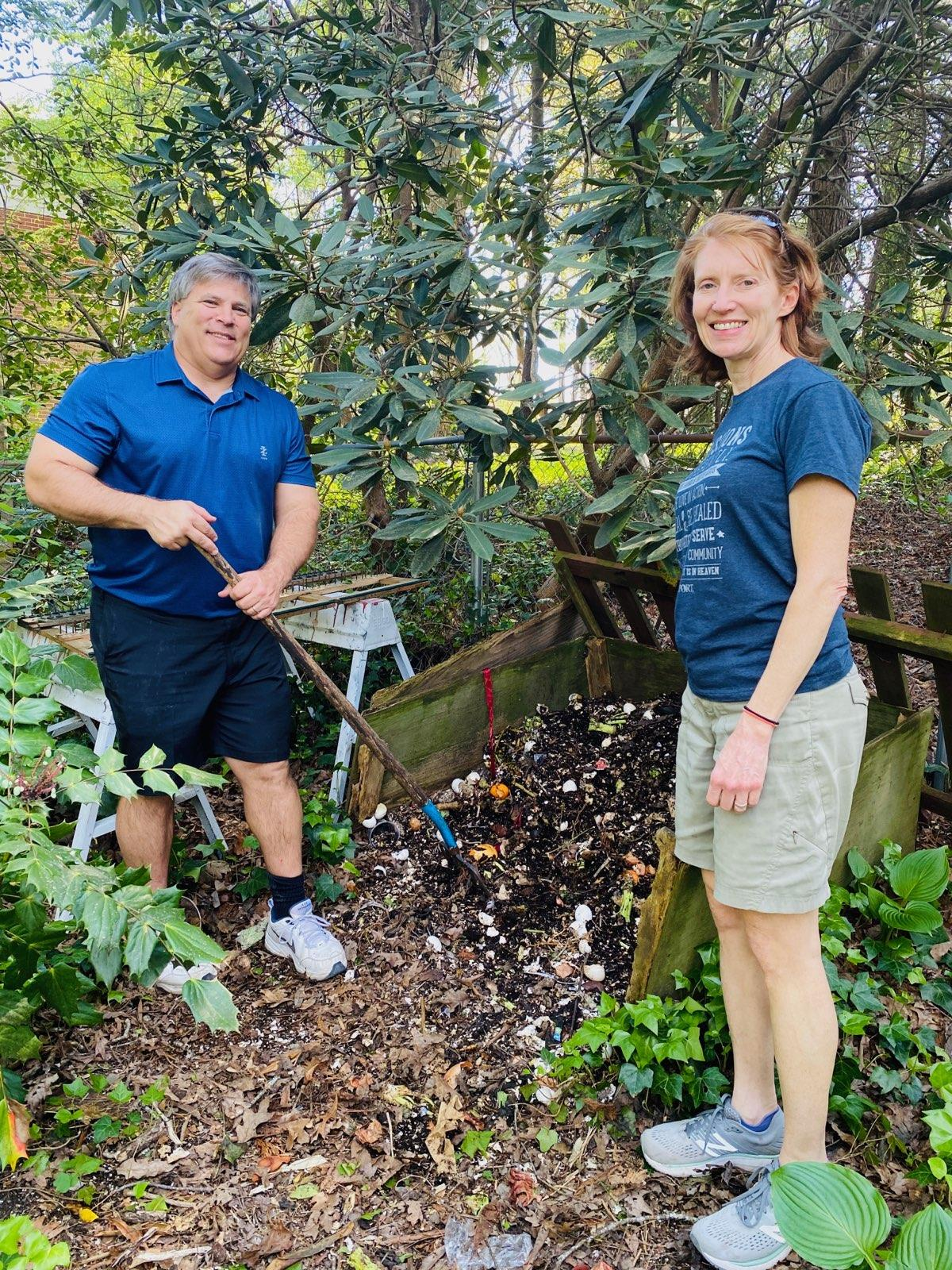 Council Member Smith and wife Anne composting